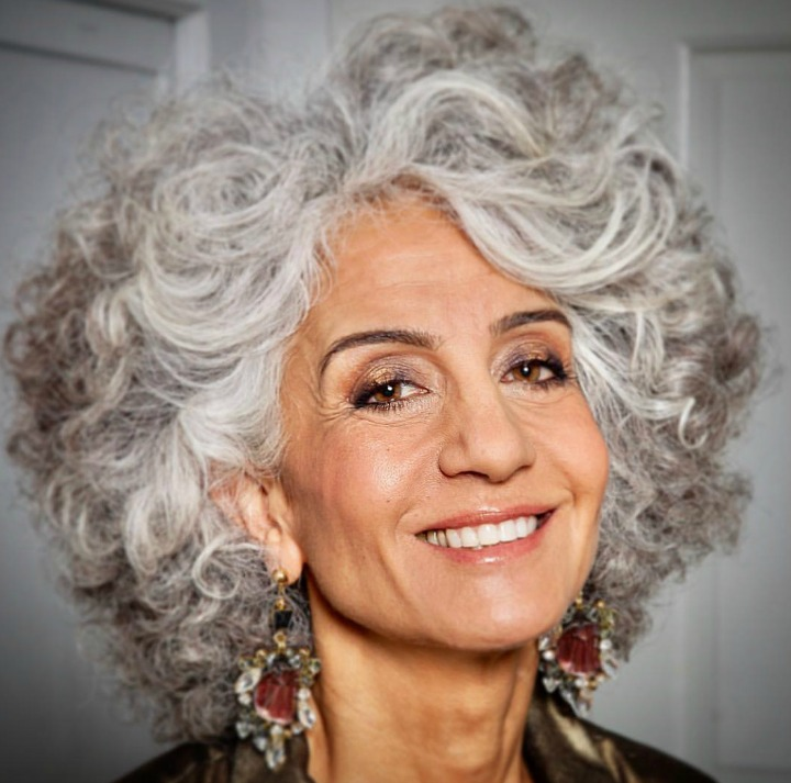 How to go gray gracefully - smiling woman with curly gray hair