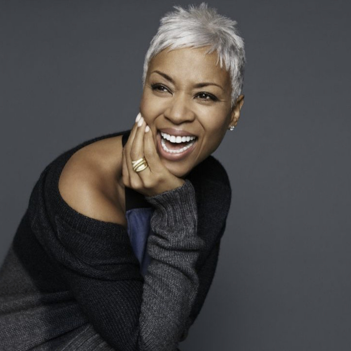 How to go gray gracefully - smiling woman with gray pixie cut