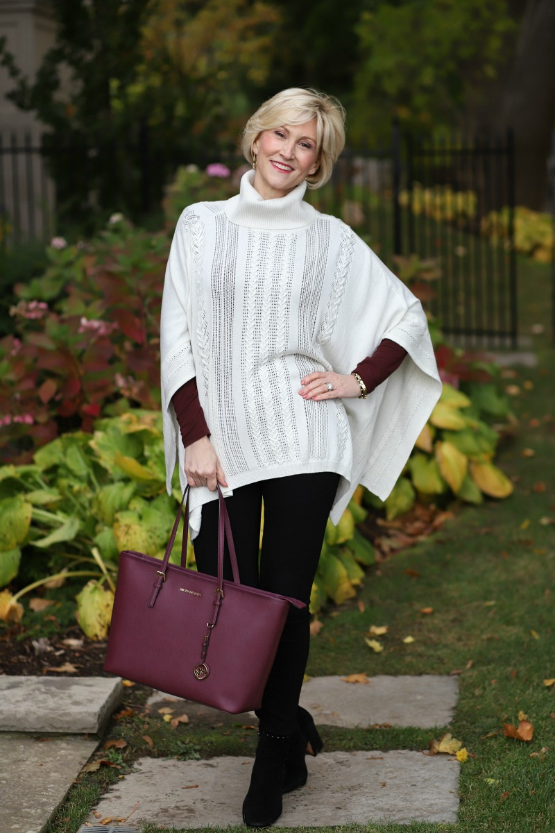 Cream braided poncho and balck jeans
