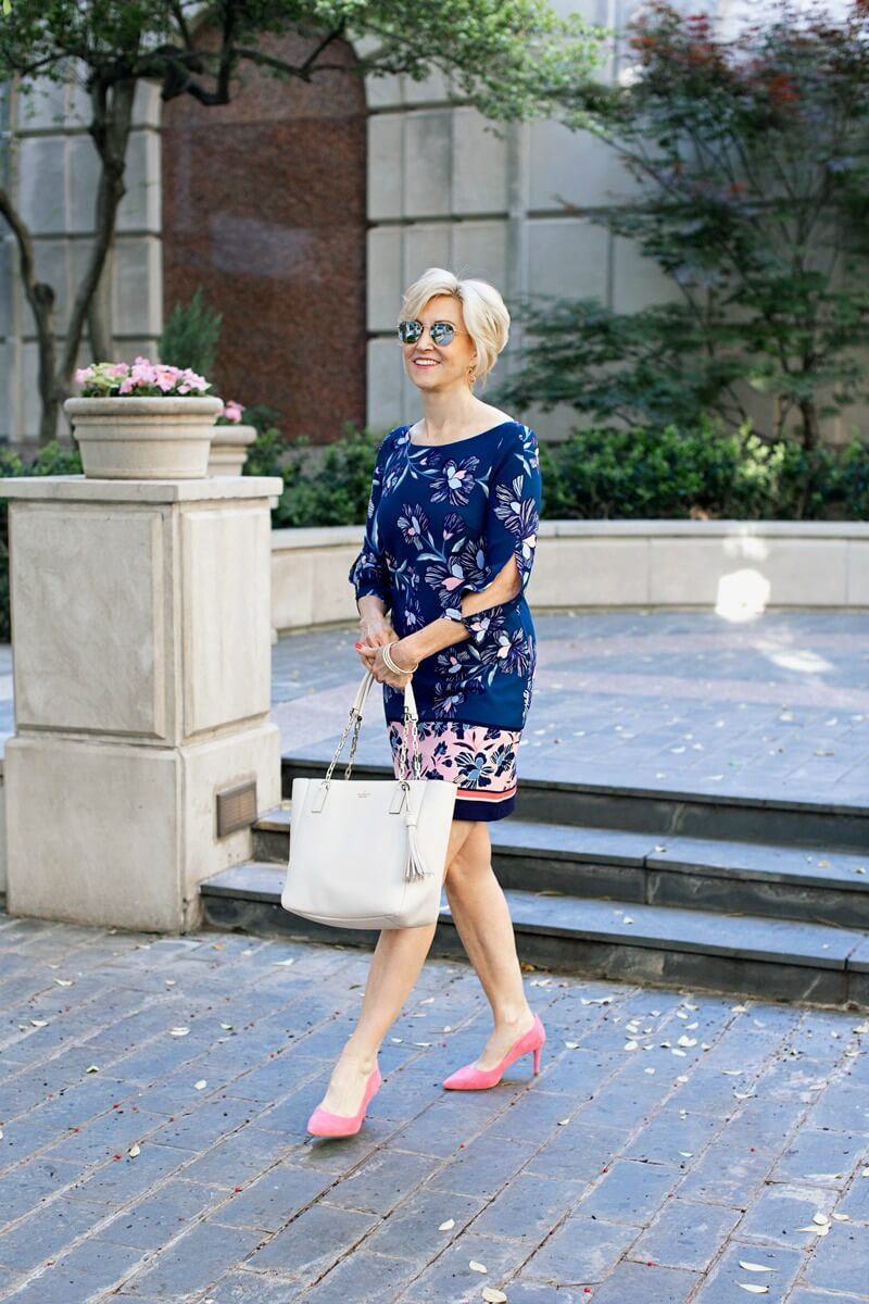 blue floral shift dress and white purse