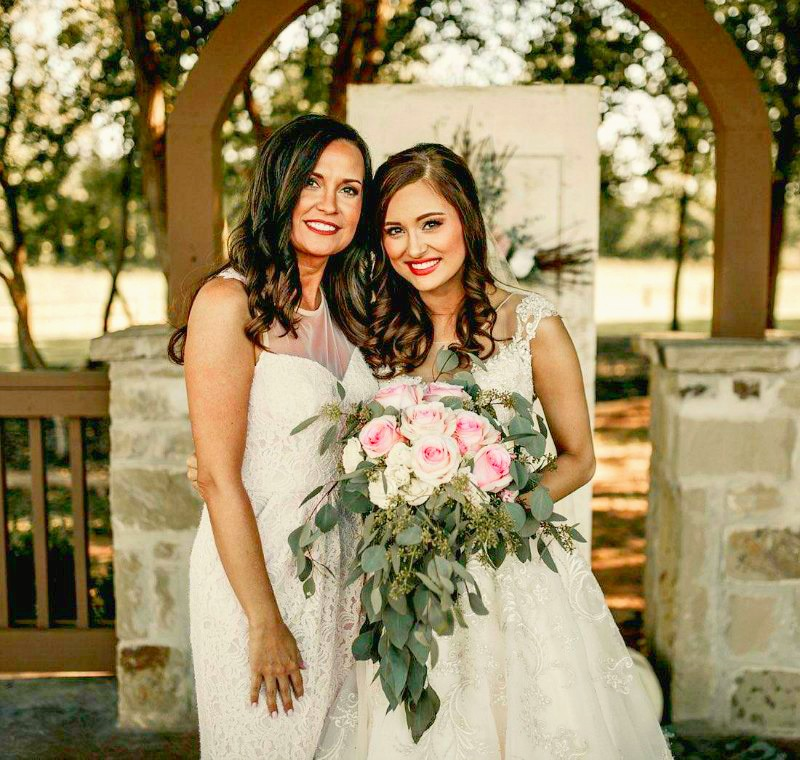 mother of the bride dress in pink lace with bride